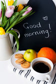 Tulips, morning coffee, fruit and chalk board — Stock Photo
