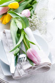 Table setting with tulips — Stock Photo