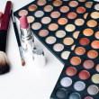 Colorful eyeshadows, lipstick and makeup brushes - Stock Photo