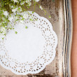 Vintage tray, white napkin and flowers - Stock Photo