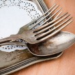 Vintage cutlery tray and old wooden board - Stock Photo