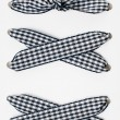 Lacing of black and white checkered ribbon — Stock Photo