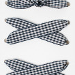 Lacing of black and white checkered ribbon - Stok fotoğraf