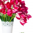 Bright pink tulips in a white vase — Stock Photo