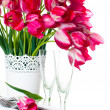 Table setting with pink tulips and vintage wine glasses — Stock Photo