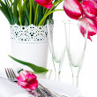 Table setting with pink tulips and vintage wine glasses - Stock Photo