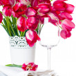 Holiday table setting with pink tulips — Stok fotoğraf