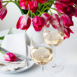 Two glasses of white wine on a table — Stock Photo #25025843