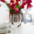 Three empty wine glasses on a table — Stock Photo