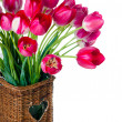 Bright pink tulips in wicker basket — Stock Photo #25025901