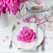 Festive table setting with pink peonies — Stock Photo