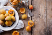 Rustic still life with apricots — Stock Photo