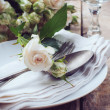 Vintage table setting with roses — Stock Photo