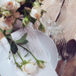 Vintage table setting with roses — Stock Photo #28952045