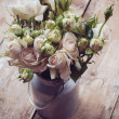 Bouquet of roses in metal pot — Stock Photo #28952127