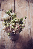 Bouquet of roses in metal pot — Stock Photo