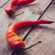 Two spicy red peppers — Stock Photo