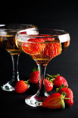 Two glasses of cold champagne with strawberries — Stock Photo