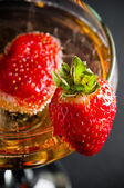 Champagne with strawberries — Stock Photo