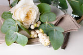 Festive table setting with floral decoration — Stock Photo