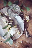 Vintage table setting with floral decorations — Stock Photo