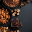 Chocolate, nuts, sweets, spices and brown sugar — Stock Photo #32329107