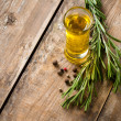 Cooking oil and fresh rosemary — Stock Photo