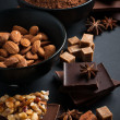 Chocolate, nuts, sweets, spices and brown sugar — Stock Photo #32328797