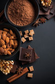 Chocolate, nuts, sweets, spices and brown sugar — Stock Photo