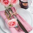 Beautiful festive table setting with roses — Stock Photo #32839149