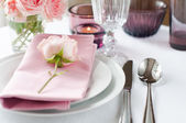 Beautiful festive table setting with roses — Stock Photo