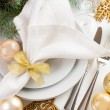 Christmas table setting in gold tones — Stock Photo