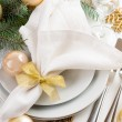 Christmas table setting in gold tones — Stock Photo #33080677