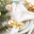 Christmas table setting in gold tones — Stock Photo #33080905