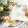 Christmas table setting in gold tones — Stock Photo #33080973