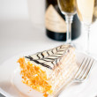 Champagne in glasses and a dessert — Stock Photo #33824811