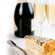 Champagne in glasses and a dessert — Stock Photo #33824923