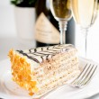 Champagne in glasses and a dessert — Stock Photo #33824975