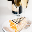 Champagne in glasses and a dessert — Stock Photo