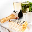 Champagne in glasses and a dessert — Stock Photo #33830315