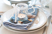 Table setting in maritime style — Stock Photo