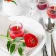 Table setting with red buttercup flowers — Stok fotoğraf