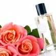 Perfume bottle and a bouquet — Stock Photo
