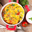 Vegetable casserole in a red pot — Stock Photo