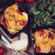 Постер, плакат: Two dishes of vegetable casserole