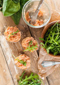 Sandwiches with salmon pate and arugula — Stock Photo