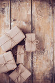 Gift boxes, postal parcels on wooden board — Stock Photo