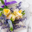 Table setting with freesias — Stock Photo #40423353