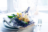 Table setting with freesias — Stock Photo
