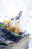 Table setting with freesias — Stock Photo